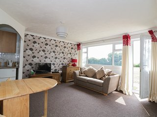 NO.1 WAVENEY, on holiday park, all ground floor, parking, shared grounds, in