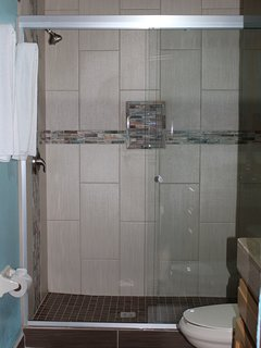 Walk in shower in the first bathroom