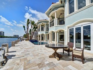 4 beds, 5 1/2 bath, stunning waterfront Estate close to everything!!