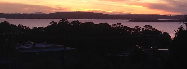 Sun set from the deck at Riverview garden, a glass of wine and a barbecue