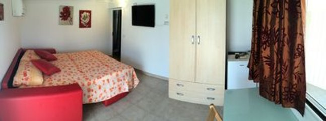 Room includes a double bed, armadio, microwave, refrigerator, desk, chairs, airconditioner, and wifi