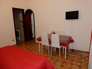 Camera da letto principale , tavolo con sedie