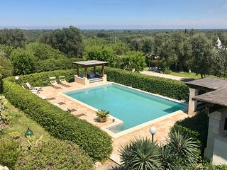 Hilltop property with pools, great amenities, outdoor areas and panoramic views
