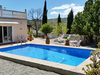 Country Finca set in elevated position. Private yet within 10 mins walk to town.