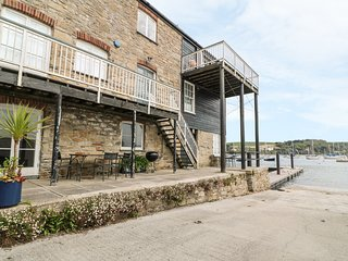 QUAYSIDE, sea views, open-plan, patio area, pontoon and private slipway in
