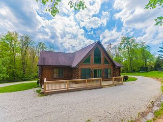 Gorgeous log home suited for six! Fenced in yard, private pond and play area!