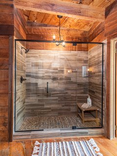 Main bathroom with shower, toilet and sink.