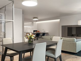 Large open-plan living and dining areas, with two bedrooms and two bathrooms.