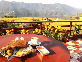 Unforgettable view of fewa lake while sipping on your coffee