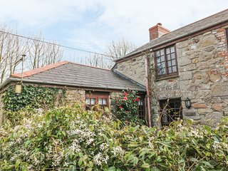 THE COTTAGE, pretty, pet friendly, single storey cottage with use of indoor