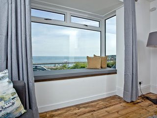 Lighthouse View - A spacious coastal retreat with stunning sea views close to Br