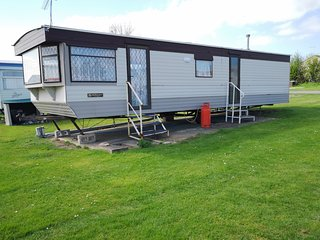 Large 2 bed caravan, separate dining & lounge area. FREE parking behind caravan