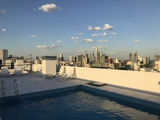 Just blocks from San Telmo Market w/ Rooftop Pool and gym! Perfect for families!
