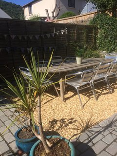 Rear courtyard garden with seating for 12 and BBQ