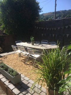 Rear courtyard garden with view to downs