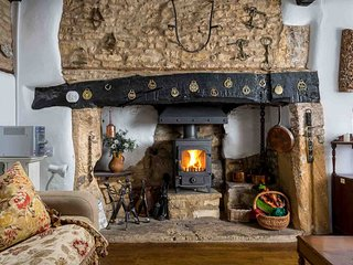 ...including a large inglenook fireplace with a wood burning stove stove