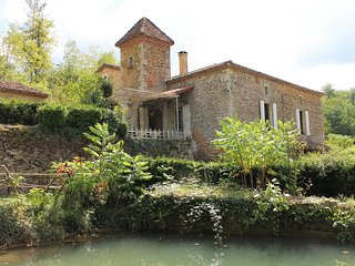 Watermill overlooking a small river in Perigord