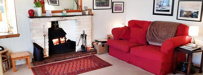 Bright living room with log burner