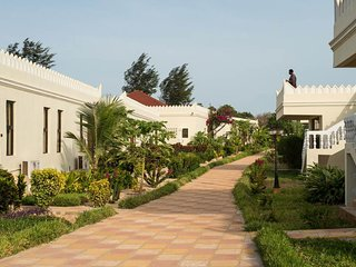 Enjoy the wonderful view of the garden wail relaxing after a day on the beach