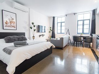 #303408 . 1820s Boutique Loft with AC | 100 Walk Score