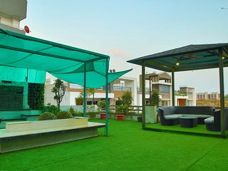 StayEden - Luxurious 3BHK with Home Theater & Rooftop Garden