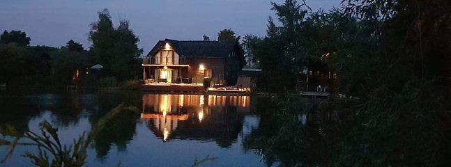Aqua Lodge at night.