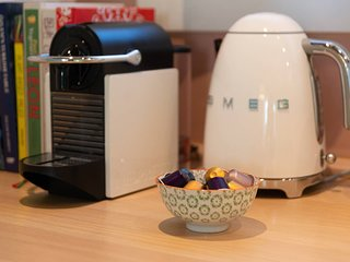 Cookbook inspirations and Nespresso coffee machine with complimentary capsules
