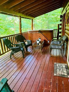 Relaxing hot tub on back deck with new deck furniture