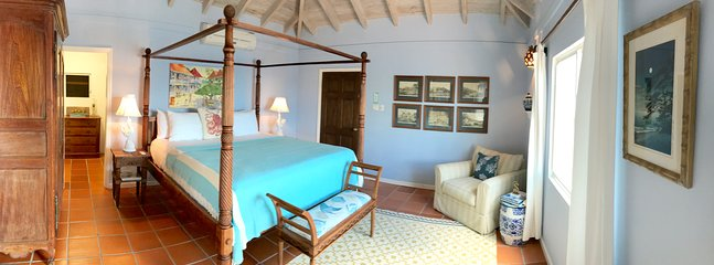 Master bedroom with king size bed, air conditioner, ceiling fan,  private deck, outdoor shower.