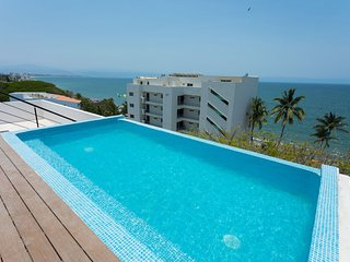 Dream Location! Walk to the beach! Beautiful condo with pool overlooking ocean.