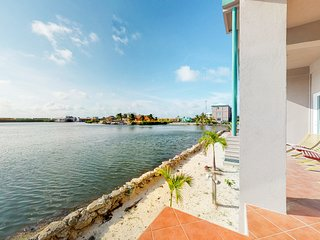 Lagoon-front, ground-level condo with shared pool - close to the beach