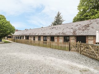 THE OLD STABLES, pet-friendly single-storey luxury cottage, en-suite, garden