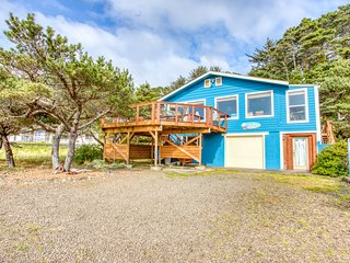 Dog-friendly home with ocean views, easy beach and bay access & a shared pool!