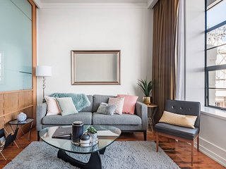 City and Harbour Views From a Stylish CBD Apartment