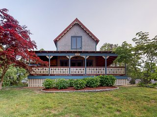 Victorian cottage w/ nearby water access, a spacious porch, & two master suites