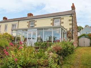 NANVIVIAN, traditional cottage with lovely sea views in idyllic spot
