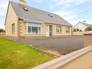 THE COTTAGE, WiFi, pet-friendly, gardens, open fire, stove, near Quilty, Ref