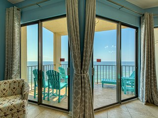 Casual beachfront getaway w/ a shared pool, ocean views, & beach access