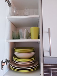 Organized cuboard with new sets of plates
