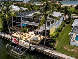 SO MUCH FUN! Key West Style Waterfront Home w/Dock; Huge Screened Lanai w/TV, Po