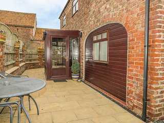 THE BARN, woodburning stove, upside down accommodation, working farm in Burton