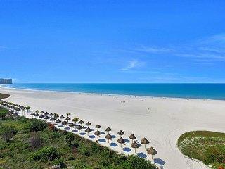 Sun-brightened beachfront condo w/ heated pool & southwest-facing balcony