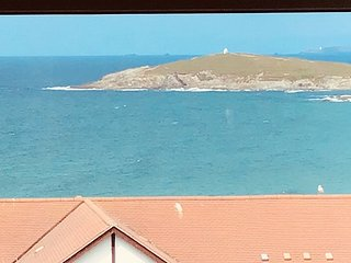 View over Fistral Beach from lounge window.