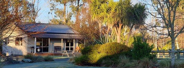 Early morning winter sun on Titiroa Cottage