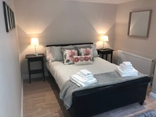 Double bedroom with wardrobes, dressing table and hairdryer. Luxury Egyptian cottan linens.