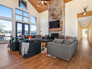 Stunning home in a private setting w/ a gas fireplace, firepit, & mtn views