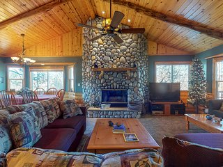 NEW LISTING! Warm and cozy log home with expansive deck and fantastic views!
