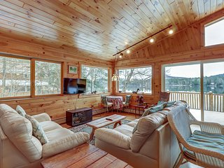 NEW LISTING! Lakefront, two-story Adirondack log cabin with dock and sandy beach
