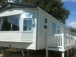 ABI Oakley. New caravan side gated decking with sea view