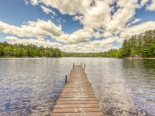 NEW LISTING! Lakefront cabin with sandy beach, dock, multiple fireplaces